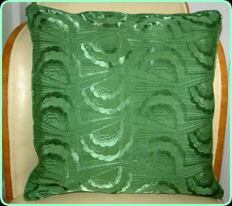 Art deco cushion, new/old green satin with cloud and ray effect.