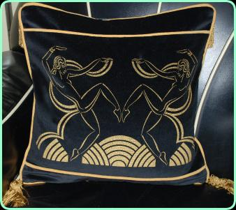 Art deco cushion, dancing girls in black velvet with gold piping trim and tassels